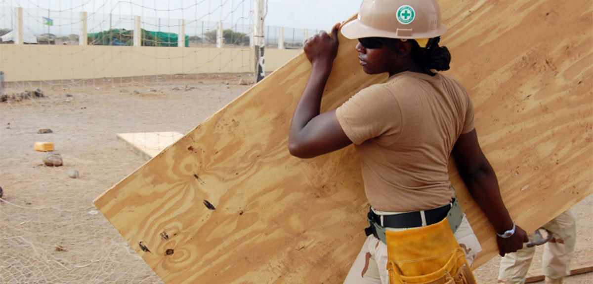Construction worker from Oxfam report cover