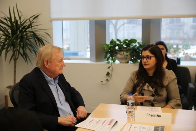 Cheistha Kochhar speaks as Ron Gibbs, to her right, listens.