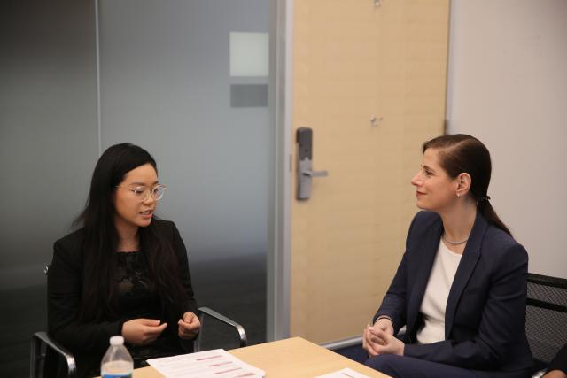 Xiaoxi Wang and Dean Katherine Baicker look at each other in conversation.