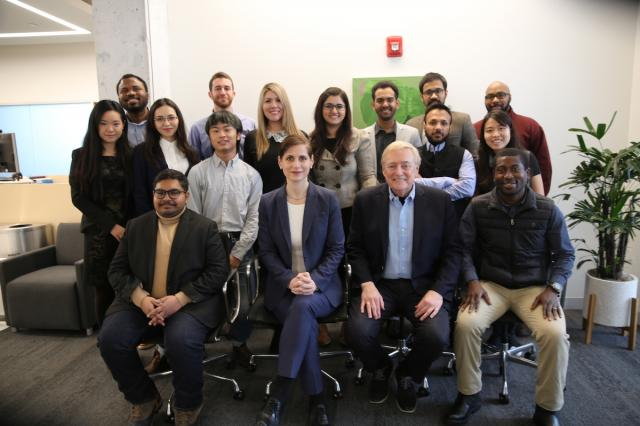 Group photo with Dean Baicker and Ron Gibbs, seated.