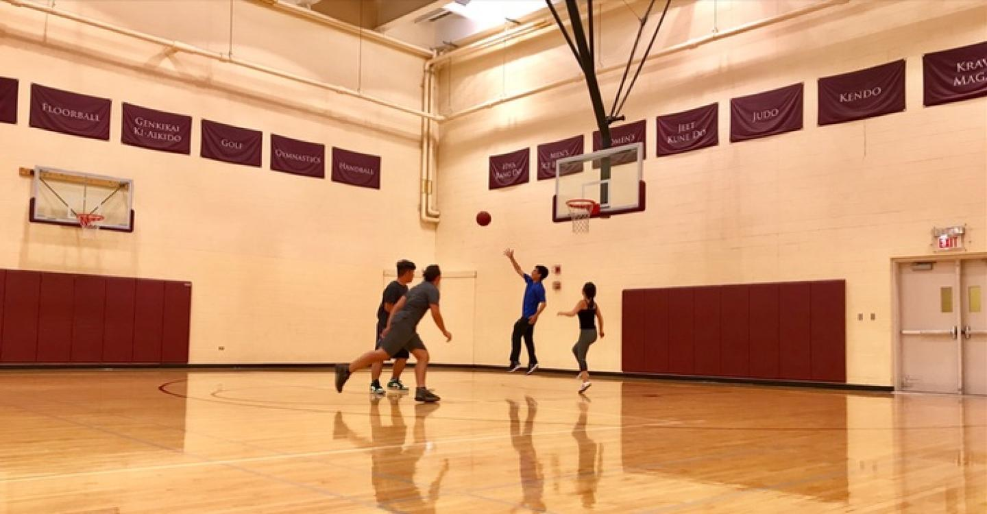 A group of 2019 DPSS students start an international basketball game in the Ratner Athletics Center.