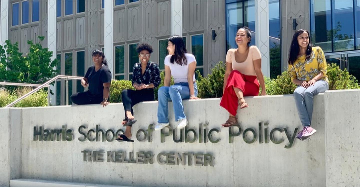 A group of 2019 DPSS students sunning on the sign in front of Harris' Keller Center.
