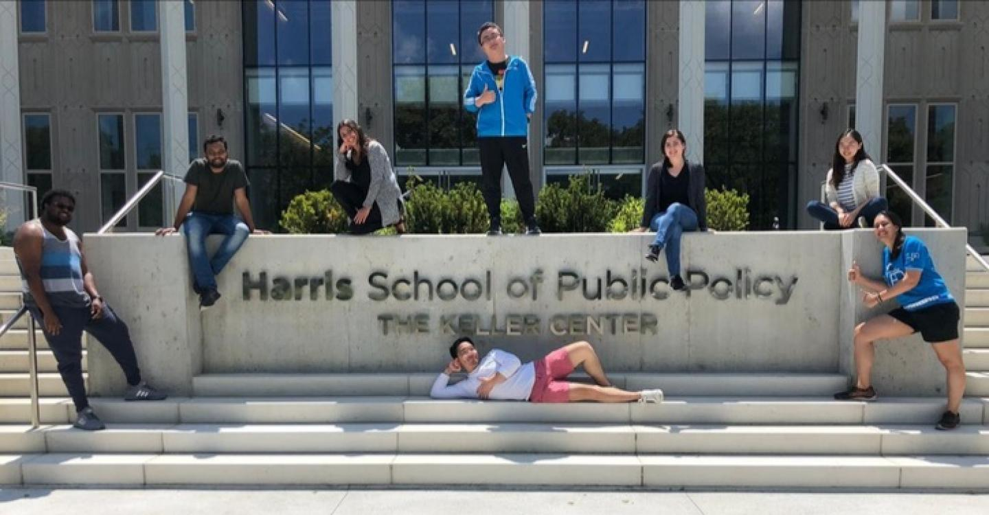 A group of 2019 DPSS students around the sign in front of Harris' Keller Center.