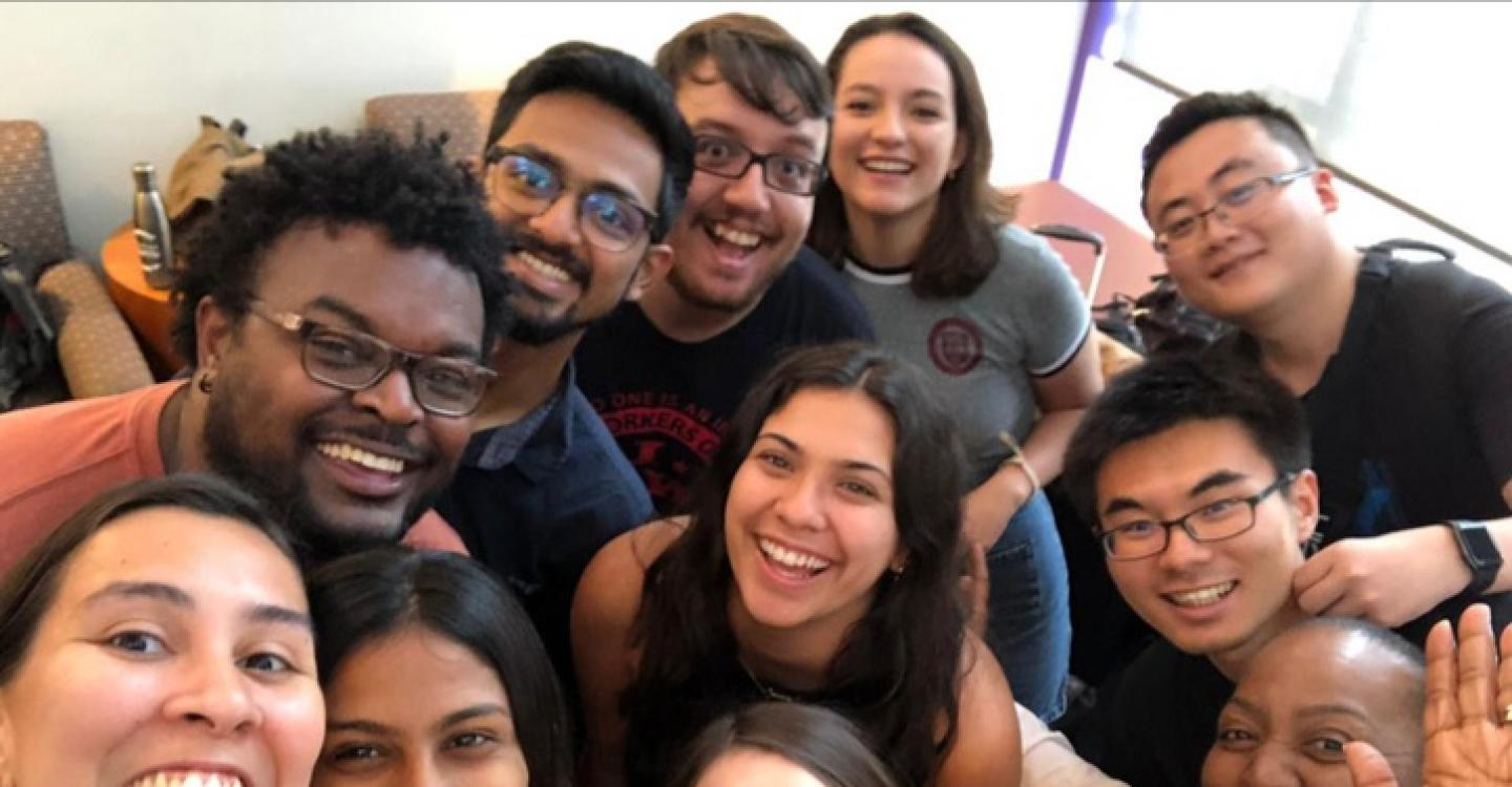 A group of 2019 DPSS students pose for a photo in the dorms on their last day in UChicago.